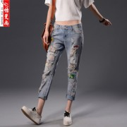 新款女士牛仔裤九分牛仔裤女宽松修身显瘦个性破洞贴布图案跨裤潮
